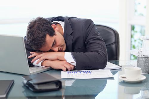 Tired Man At Desk