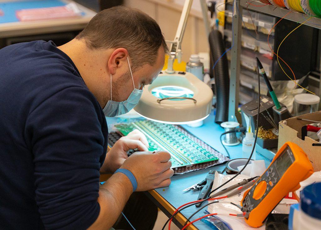 Engineer testing PCB prototype